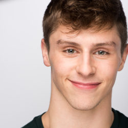 Adam Vesperman smiling wearing a black shirt