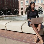 girl sitting at fountain in dance clothes