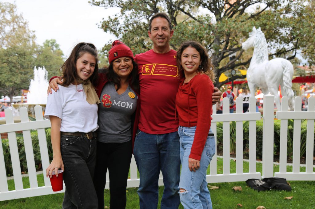 Two young women with parents in USC clothing