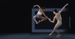 one dancer jumping and the other holding her hand