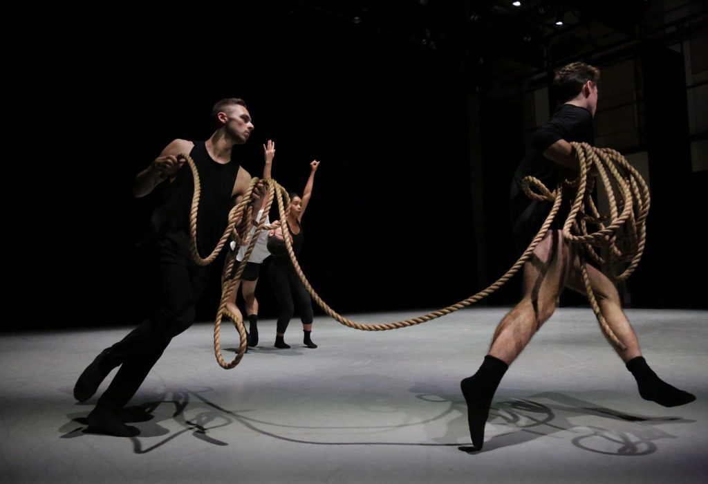 Dancers running with rope.