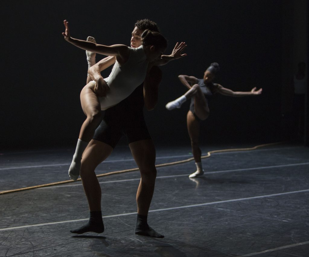 Dancers doing a duet and a solo.