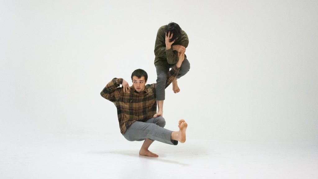JA Collective dancers in intricate balancing pose