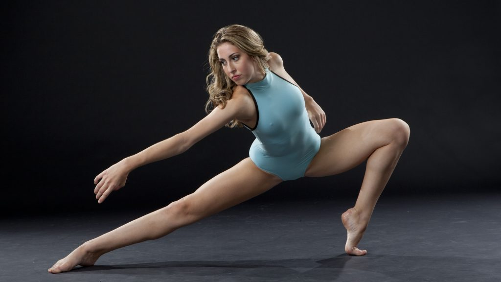 Woman in sideways lunge with arm out