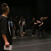 Director watching dancers execute handshake movement
