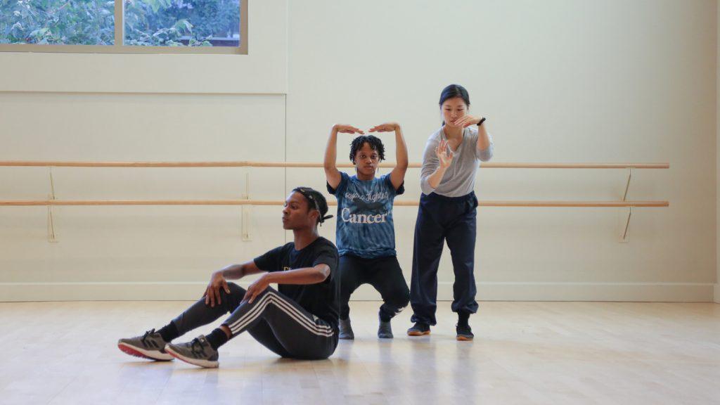 Three dancers side by side