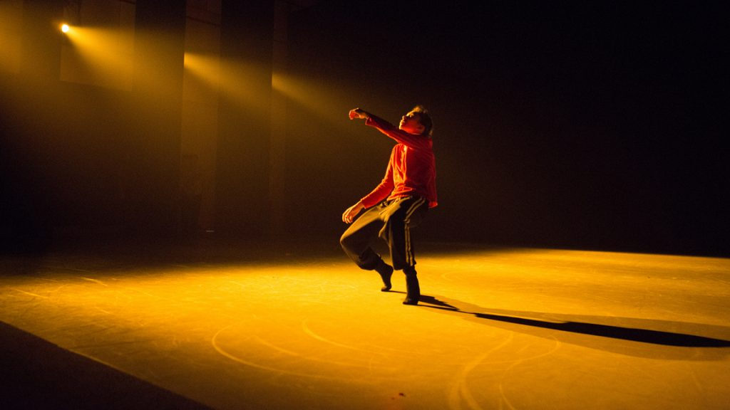 Dancer solo onstage with blindfold