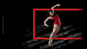 dancer wearing red leotard with music notes in background
