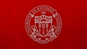 white USC seal on cardinal background