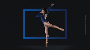 dancer wearing blue long sleeved leotard in arabesque with blue box around her