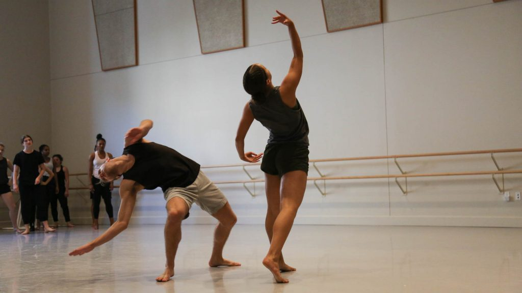 two dancers rehearsing in a studio