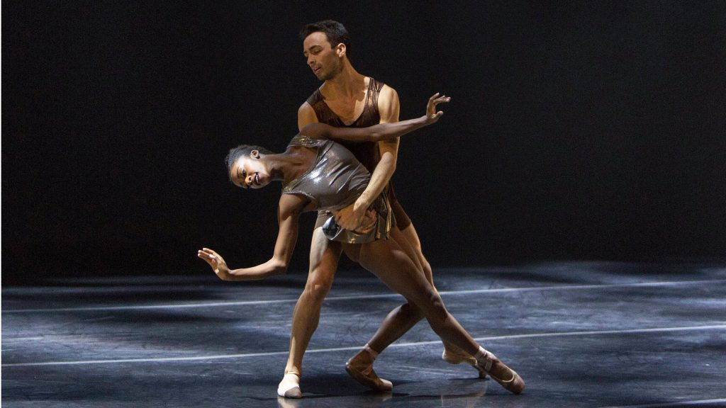 ballerina and male ballet dancer partnering onstage