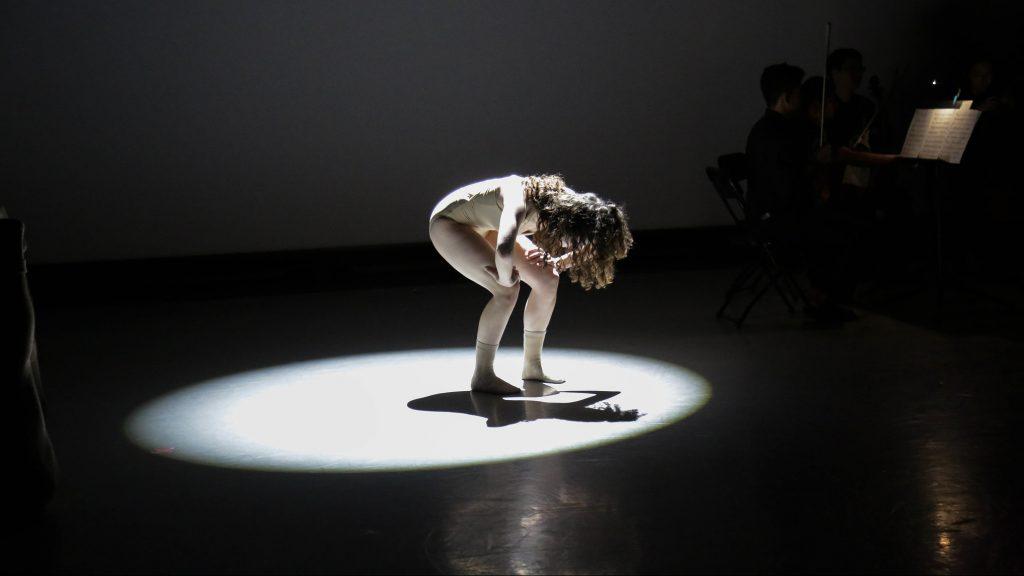 Girl alone onstage in spotlight