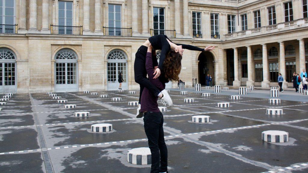 man lifting woman in palace