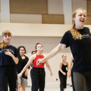 Woman leading dance class at Taylor intensive