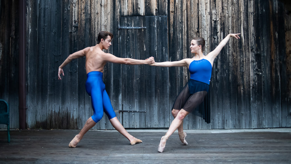 man and woman dancing outside in blue dance attire