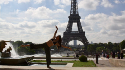 Woman dancing in front of eiffel tower