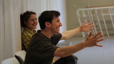 Man teaching dance in striped shirt