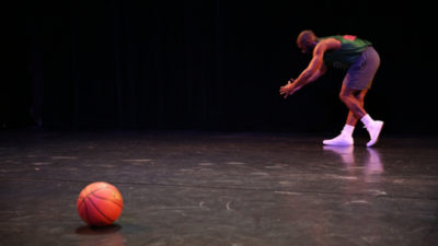 man dancing at REDCAT with basketball