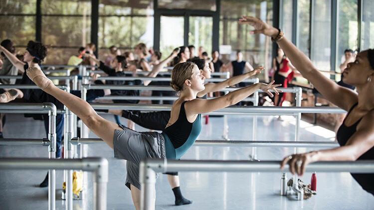 dancers at barre in arabesque