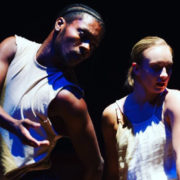 two dancers looking away with serious faces