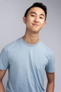 Justin Pham wearing a light blue t-shirt