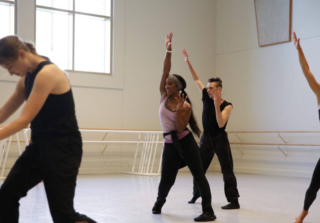 Saleemah demonstrates an angular pose for one of her students in the studio