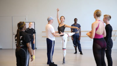 William Forsythe partners Eileen Kim as she balances with one leg extended behind them