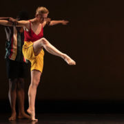 Two dancers partnering on stage