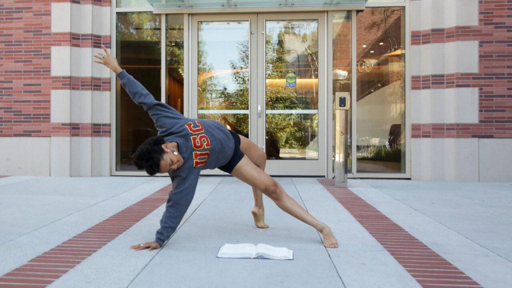 Rachel Harris dancing in front of the Glorya Kaufman International Dance Center