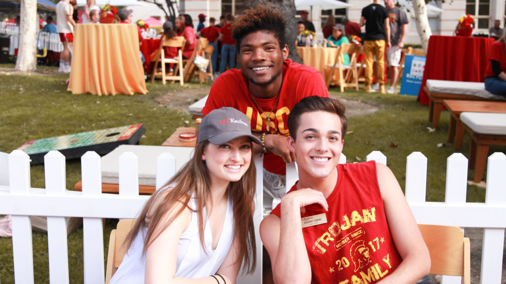 Zackery Torres at a USC Kaufman tailgate with Sidney Chuckas and Elise Monson.