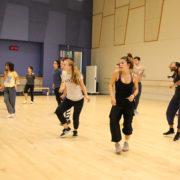 dancers taking hip-hop class in studio