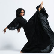Shannon Grayson dancing in a black dress