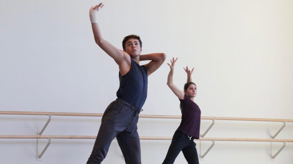 Zackery Torres dancing in dark clothing in a USC Kaufman studio.