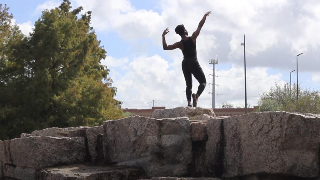 Screenshot of Munachimso Mbaezue dancing on a rock