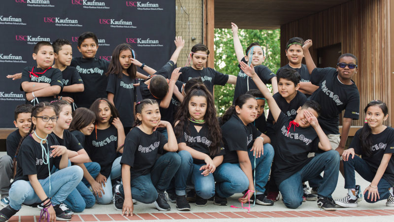 32nd Street Elementary School students pose wearing black Dance On t-shirts