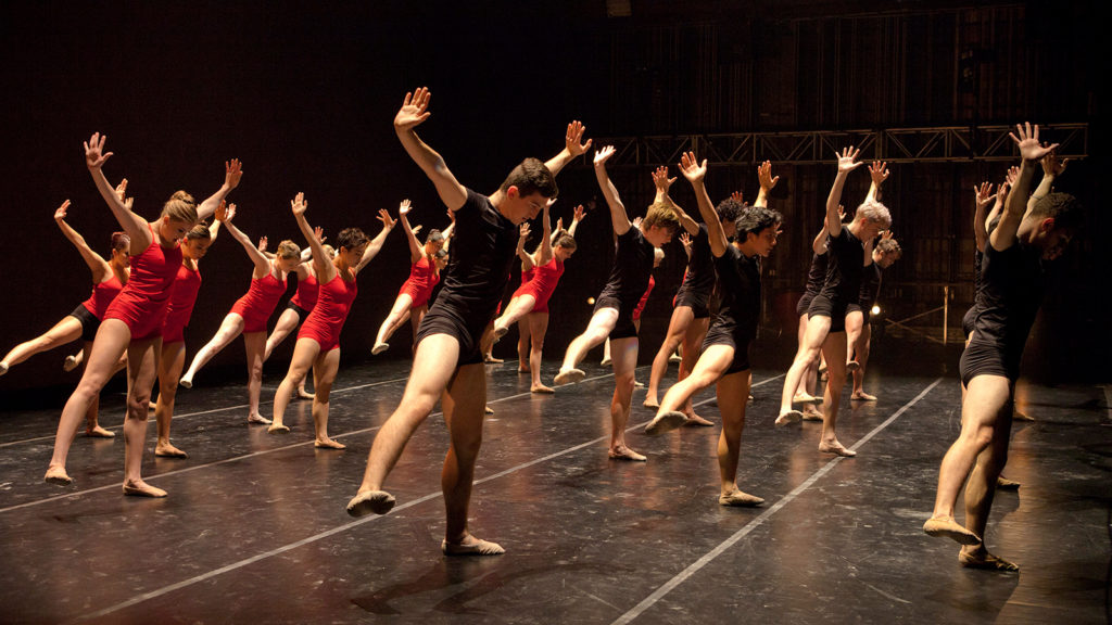 Dancers wearing red and black