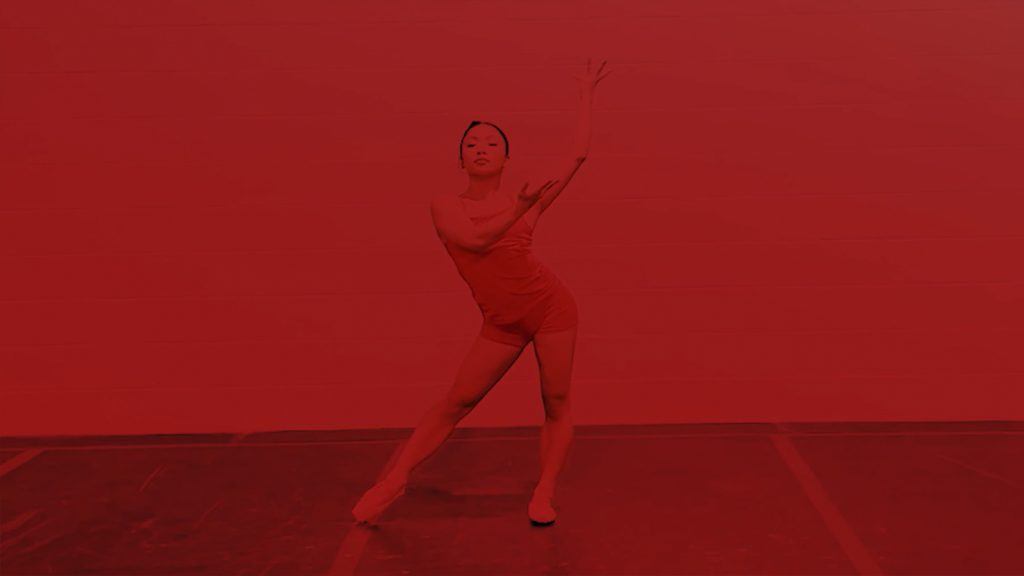 Dancer wearing pointe shoes with a red overlay
