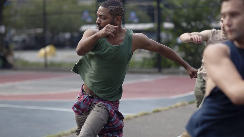 Kyle Abraham dancing on a basketball court
