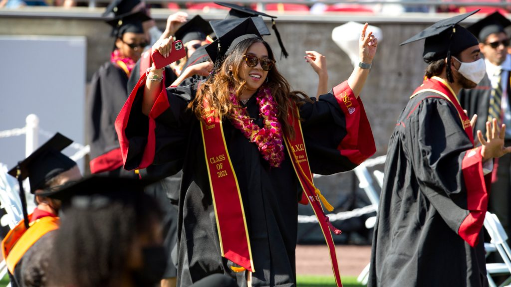 Makayla Bailey wearing sunglasses, cap, and gown