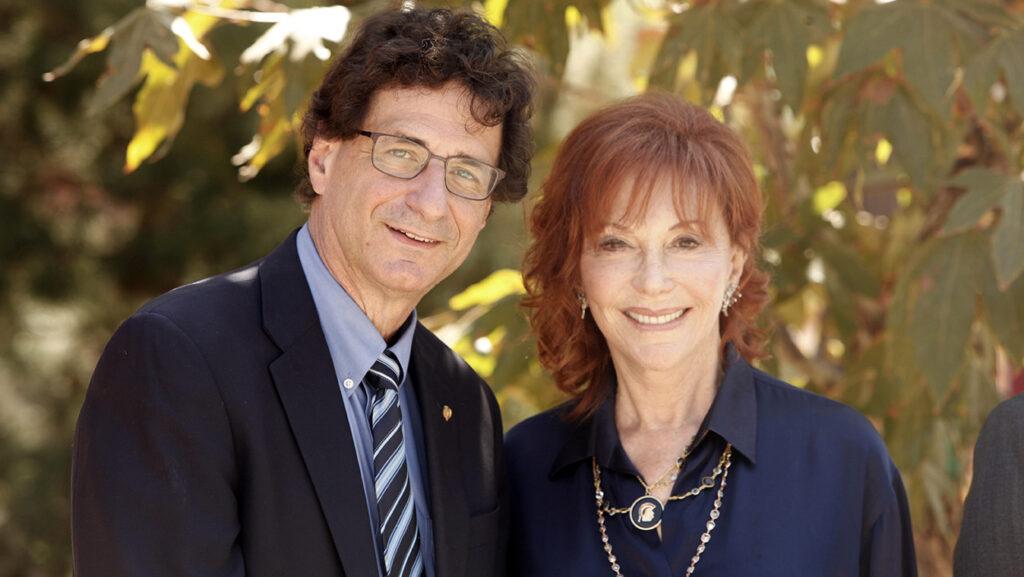 Rob Cutietta and Glorya Kaufman smiling