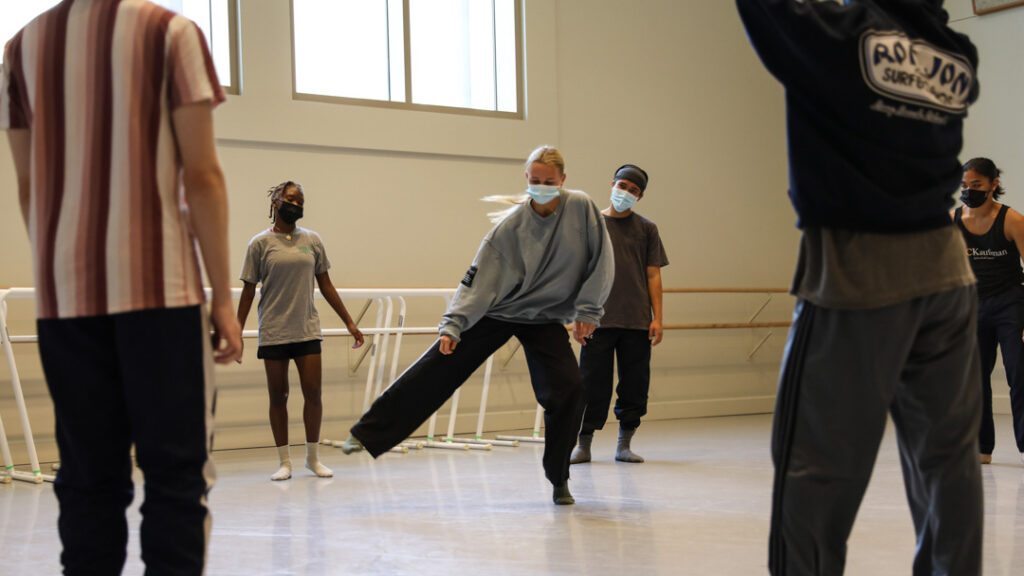 dancers in a cypher wearing masks