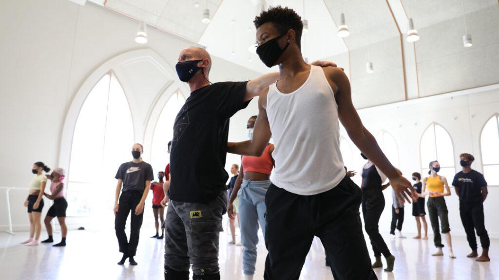 dancers wearing masks