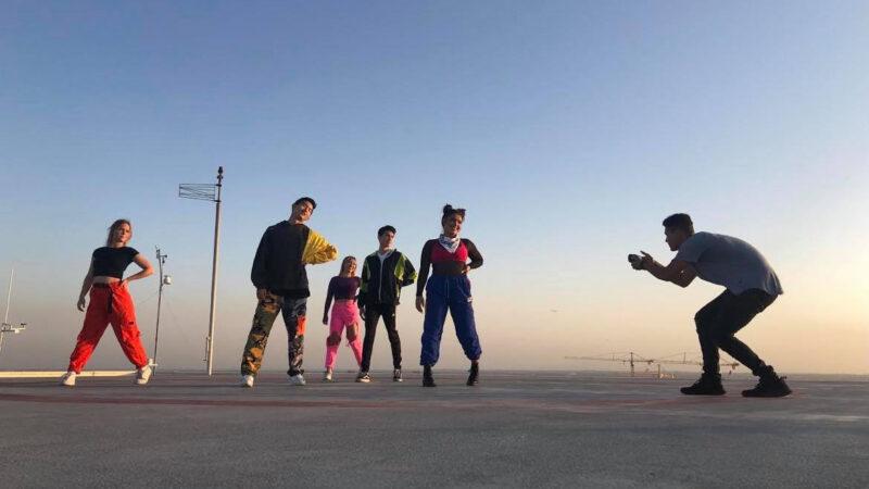 hip-hop dancers being filmed by a videographer