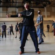 Peter Chu wearing maroon mask, black sweatshirt, and navy sweatpants